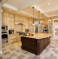 I love that the cabinets extend to the ceiling yet still have that staggered look.