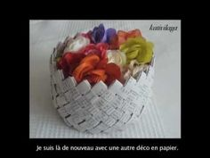 pretty paper basket of paper strips, like the candy wrapper weave