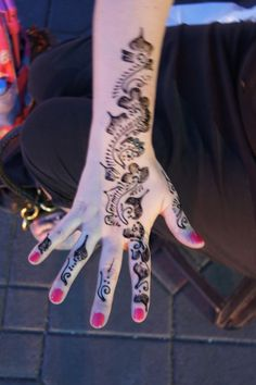 Henna painting. I tried it and it takes for ever to put on and then wait until the next day. Looked very nice and lasted for about 3 months