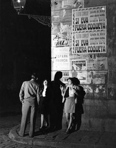 """Bert Hardy. """"Barcelona a City in Ferment - Two prostitutes talking to a client on a Barcelona street corner"""". 1951. Barcelona, Cataluña, Spain."""