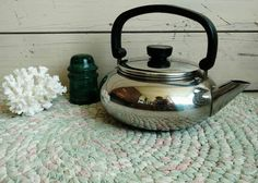 Check out this item in my Etsy shop https://www.etsy.com/listing/238552558/mid-century-paul-revere-chrome-tea