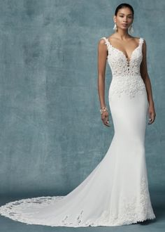 Maggie Sottero Kelsey Chic beaded lace motifs adorn the sheer bodice and illusion train in this Vesna stretch crepe sheath wedding dress, completing the straps, illusion plunging sweetheart neckline,. Crepe Wedding Dress, Maggie Sottero Wedding Dresses, Crepe Dress, David Tutera Wedding Gowns, Sheath Wedding Dresses, Western Wedding Dresses, Wedding Dress Pictures, Dressy Dresses, Bridal Gowns