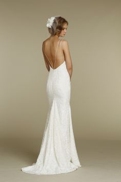Gorgeous a-line wedding gown with spaghetti straps and a low back
