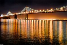 The San Francisco-Oakland Bay Bridge - Oakland, CA, United States. Long exposure capture of the Bay Bridge and light installation.  View from along the Embarcadero and Pier 14 for photo ops.
