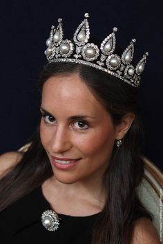 "A Christie's auction house employee wears The Rosebury pearl and diamond tiara, bracelet and brooch on June 6, 2011 in London, England. The jewels, which formerly belonged to Hannah, Countess of Rosebury, feature in Christie's ""Important Jewels"" sale which take places in London on June 8, 2011."