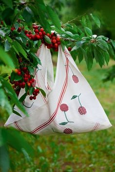 Linen tea towel with embroidered cherries cross-stitch and sewn like a sack