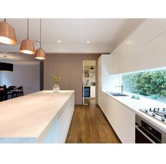 Kitchen. Window splash back, lighting. Open plan, simple and modern