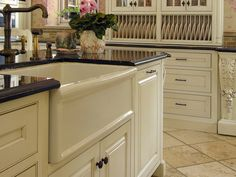 This is a gorgeous traditional-style kitchen. Love the farmhouse sink with black countertops and white cabinets. http://www.hgtv.com/designers-portfolio/room/dp-cottage/living-rooms/5835/index.html#?soc=pinterest