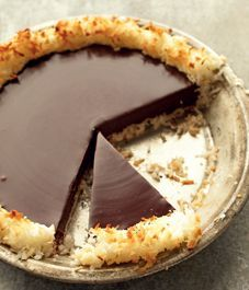 Martha Stewarts crisp coconut and chocolate pie ....FOUR ingredients and it comes out looking this heavenly. Must Try.