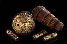 Treasures from 2,600-year-old grave of Celtic princess in Germany reveal their secrets.  Gold and amber beads from Hueneburg Celtic grave [Credit: State Office for Cultural Heritage, Baden-Wuerttemberg] Close similarities between the gold broaches worn by the woman and the child suggest that there may have been a familial relationship between the woman and child, archaeologists have reported in a paper published in the journal Antiquity.