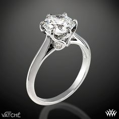 """Superb craftsmanship is on full display with the Vatche """"Swan"""" Solitaire Engagement Ring. This 6 prong beauty incorporates an open cathedral style shank with four surprise diamonds (0.07ctw"""