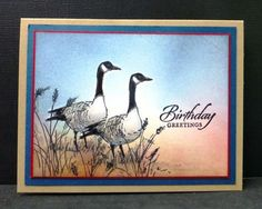 """By Sallie (hobbydujour at Splitcoaststampers). Stamp two birds on scrap or Full-Adhesive Post-It Notes to use as masks. Stamp geese in black on white cardstock panel. Temporarily position masks over stamped geese. Brayer or sponge background (Cherry Cobbler, MidnightMuse, Baked Brown Sugar). Stamp grasses in black. Remove masks. Stamp sentiment. If you wish, color parts of geese with gray. Layer panel onto red mat then blue mat then kraft card base. Stamps from """"Wetlands"""" (Stampin' Up)."""