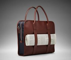 """The '14"""" Trillo Messenger' bag is offered in dark brown Vachetta leather with water resistant dark blue nylon lining. This discreetly practical bag includes an outside leather strip to hold the daily newspaper along with an adjustable, detachable leather shoulder strap, and a separate inner section to fit up to a 14-inch laptop."""