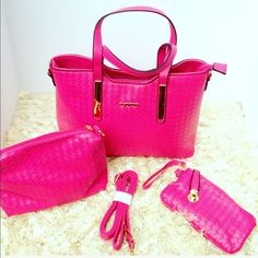 Beautiful Raspberry Handbag Gorgeous weave design plenty of storage in the main bag that is 13 inches wide, 10 inches tall , 5 inches at the base which has beautiful gold base at each corner. Beautiful raspberry color. Comes with all items pictured. Bags Shoulder Bags