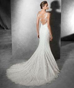 свадебный салон FASHION BRIDE Только в сети салонов #FashionBride! Свадебные платья от испанского бренда #Pronovias в наличии! Чудесное свадебное платье из жоржета, с заниженной талией и вырезом в форме сердца. Роскошное свадебное платье силуэта «русалка», с очаровательным цветочным кружевом и вышивкой драгоценными камнями.
