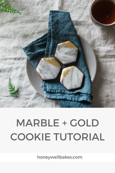 Things you'll need: Hexagon cookie cutter (try Ebay) Hexagon cookies (see our recipe on YouTube) White fondant ready to roll icing Black gel food colouring Food grade gold leaf   To make marble icing, use a cocktail stick or the...