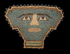 Faience Beaded Mummy Mask.   Comes with a custom purple hardwood stand. Originally sewn to the mummy shroud along with amulets and scarabs.  Thousands of years ago, the Egyptians hoped to achieve eternal life. They believed that the deceased would attain immortality if the body was preserved for resurrection and if the proper funerary rites were observed. The mummy mask aided the deceased in the perilous journey to the next world where it was believed that resurrection would magically occur.