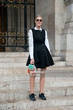 Fashion Blogger Sofie Valkiers wears a Dior dress, shirt and sunglasses, Louis…