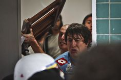 SORE LOSERS: Some of Argentina's Arsenal soccer players clashed with police officers in a locker room after they lost to Brazil's Atletico Mineiro in a Copa Libertadores soccer match in Belo Horizonte, Brazil, Wednesday. Club Arsenal paid a fine of nearly $20,000. (Bruno Cantini/Reuters)