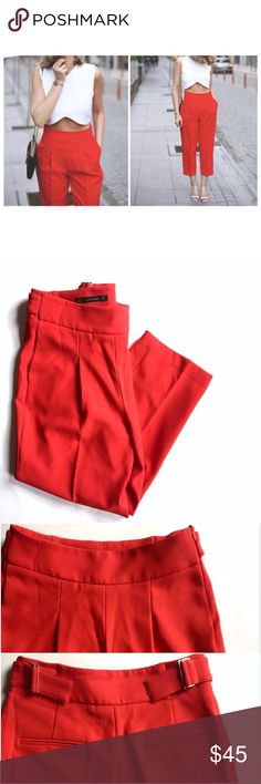"""Zara Basic Cropped Wide Leg Trousers High waisted cropped trousers from Zara Basic. Bright bold red in color, with side zipper closure and belted back for more fitted closure. Back pockets not functional, front pockets are functional. Pleated front. Perfect condition. A bit too tight on me, so letting these go  Length: 34"""" Inseam: 22.5"""" Waist: 26"""" Hip: 37"""" Zara Pants Trousers"""