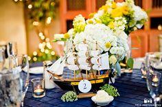 Navy, yellow and white nautical wedding reception.  Hydrangea, crespedia, roses, queen anne's lace and solidago were in the centerpieces.  Thank you Hannah Smith Events & True Photography