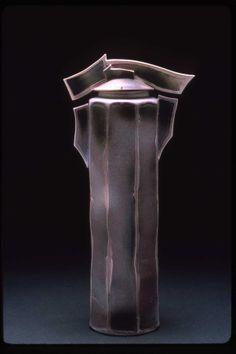 Christy Johnson - Thrown and facited ldded jar; egg-shell matt glaze over porcelain; airbrushed oxides; reduction fired.