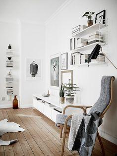 Un salon dans les tonalités de blanc et de gris