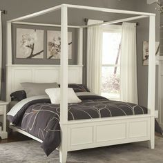 This King size Contemporary Canopy Bed in White Wood Finish would be a great addition to your home. Unadorned details such as the straight and curved lines and slightly flared legs create the contempo