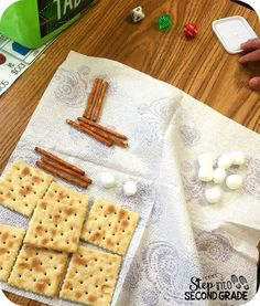 Teaching place value using saltines (hundreds), pretzel sticks (tens), and marshmallows (ones). Kiddos are sure to remember this lesson!