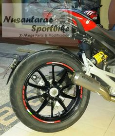It's Ducati Monster 1100 2012 rear rim attached on Ducati Monster 696 2010. It's AWESOME.