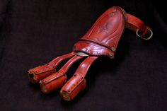 Tooled leather archery glove