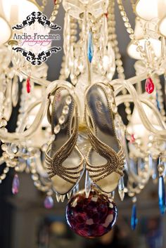 Silver jeweled strappy heels hanging in antique chandelier. Classic Fall Wedding at southern antebellum home. Photography:  Andie Freeman Photography, www.TheAthensWeddingPhotographer.com Venue:  Higdon House Inn and Gardens www.higdonhouse.com Floral:  Greg Hall and Company, www.GregHallandCompany.com Entertainment:  DJ Unlimited http://djunlimited.net Caterer:  At Your Service  http://www.atyourserviceeatonton.com/ Desserts and Cake:  Kellie's Cake  kelliscakes@hotmail.com