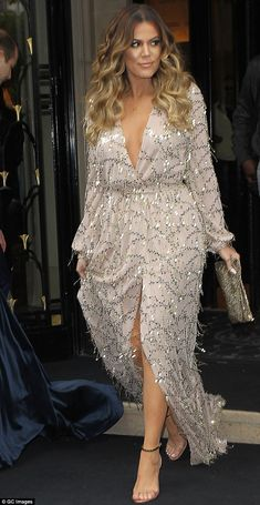 Fashion winner: Khloe Kardashian arrived at sister Kim Kardashian and Kanye West's wedding rehearsal in Versailles last week in a glimmering dusty rose Constantina and Louise dress