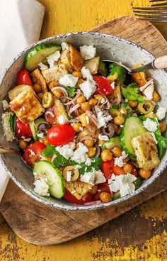 """Easy and healthy salad with cripsy chickpeas, cucumbers, tomatoes, feta, and tangy feta 