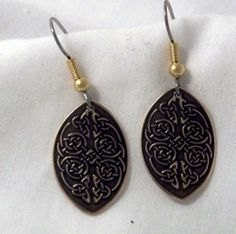 rish handcrafted etched brass Celtic earrings.  The Pictish Art of constructing knotwork designs decorates these Celtic knot earrings.  Celtic Knots are pretty famous, they also hold much meaning. The knot was unending and the strands used were intertwined with each other, which symbolized unity and protection.  Ideal ladies gift from Ireland.  Handcrafted in West Cork, Beara, Ireland by Aqua Fortress. West Cork, Celtic Knots, Iron Age, Strands, Unity, Gifts For Women, Ireland, Aqua, Brass