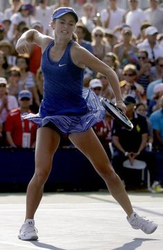 Catherine Bellis, of the United States, reacts after a point against Dominika Cibulkova, of Slovakia, during the first round of the 2014 U.S. Open tennis tournament, Tuesday, Aug. 26, 2014, in New York. #WTA #Bellis #USOpen