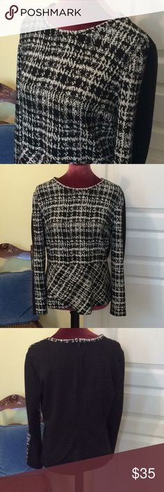 Calvin Klein Top Black and white long sleeved top.  Pattern on front  only.  Crossover front peplum that is great for camouflage.  Pullover style with zipper halfway down the back. Polyester Rayon and Spandex. Dry clean. Calvin Klein Tops