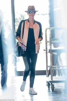 Atomic Blonde, indeed! Stunning Charlize Theron is all smiles as she arrives in Berlin to ...