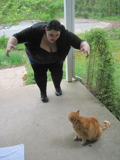 I think this one of the best, cutest and funniest pictures ever. I love everything about this girl, and her cat.