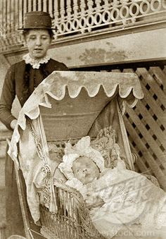 Nurse and baby at 'Nundora'. A Victorian nursemaid pushes a baby in wicker pram decorated with frills outside the Brodribb's family house 'Nundora'. Toowoomba, Australia, circa 1895.