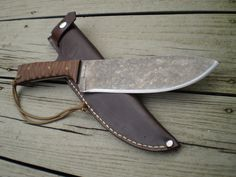 A heavily modified Condor Hudson Bay Knife.  This is an Awesome knife with an unbelievably low price!