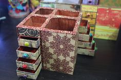 Pen holders with matchbox drawers using used corrugated boxes and flip top cigarette boxes as drawers, recycled gift wrapping papers.