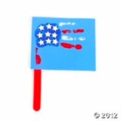 Cute 4th of July craft! -- I like the paint/flag hands