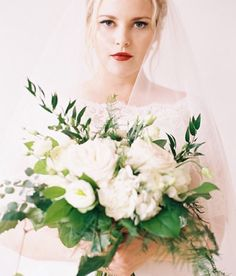 Ethereal bridal portrait by @katwillson . Wowza. Gorgeous blooms designed by @deemurrz.