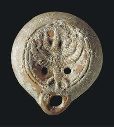 AN EARLY JEWISH TERRACOTTA OIL LAMP ROMAN PERIOD, CIRCA 1ST CENTURY A.D.