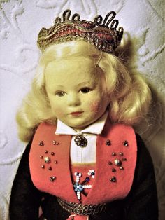 """Ronnaug Petterssen dolls were made from the 1930's until the 1970's in Norway, her dolls are made of felt cloth with a pressed mask face or celluloid head, dolls are 7 1/2"""" to 18"""" tall, and possibly larger, with a cloth stuffed body, jointed at the neck, shoulder and hip, center seams on front of legs, arms attached with fabric for movement and have stitched fingers. 