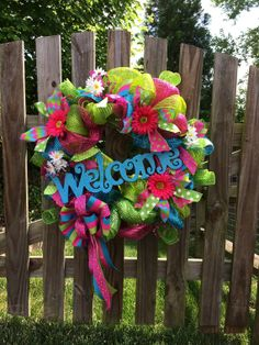 Spring/summer pink, blue, and green, pink welcome wreath (the pink welcome sign is out of stock, I have green and blue available) deco mesh on Etsy, $60.00