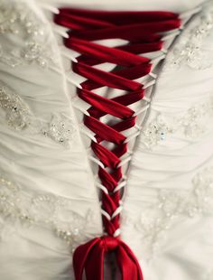 Red tie up on wedding gown
