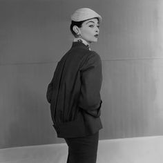Model Wearing Dior Suit and Hat.  ca. 1952