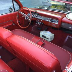 Red interior. Old cars are so much more interesting.